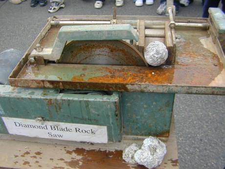 Diamond blade rock saw cutting the geode.