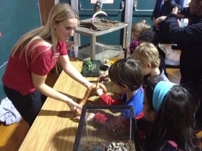 Miss Pavlicek with cornsnake, sharing with students.