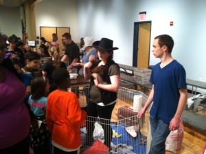 Science Center student, Sam Houvasse, with ferrets