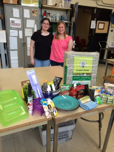 Seniors Becky and Laura with their donations to the center