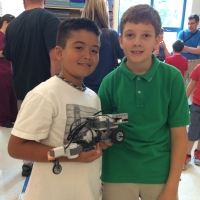 Boys with robots from summer program