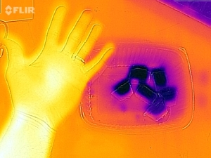 Our hand and ice cubes in infrared.